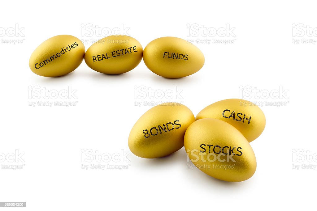 Golden eggs with types of financial investment products. stock photo
