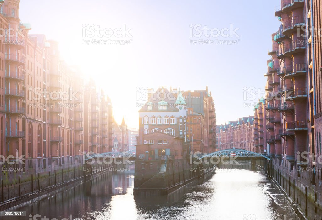 golden evening sunlight in the old warehouse district Speicherstadt in Hamburg stock photo