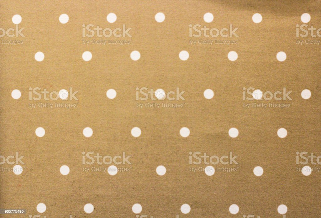 Gouden stof en een witte kleine polka stippen achtergrond - Royalty-free Afbeelding Stockfoto