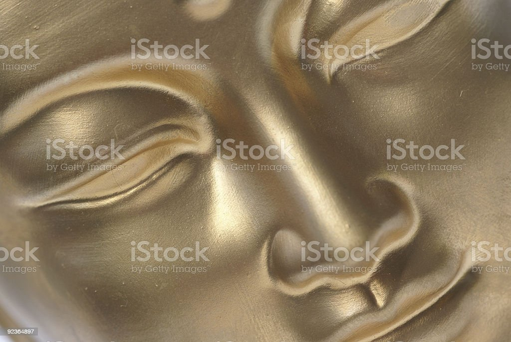 Golden face. royalty-free stock photo