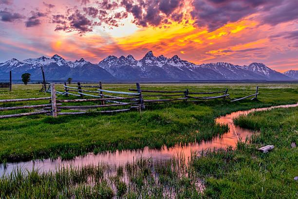Golden Fiery Sunset at Grand Teton stock photo