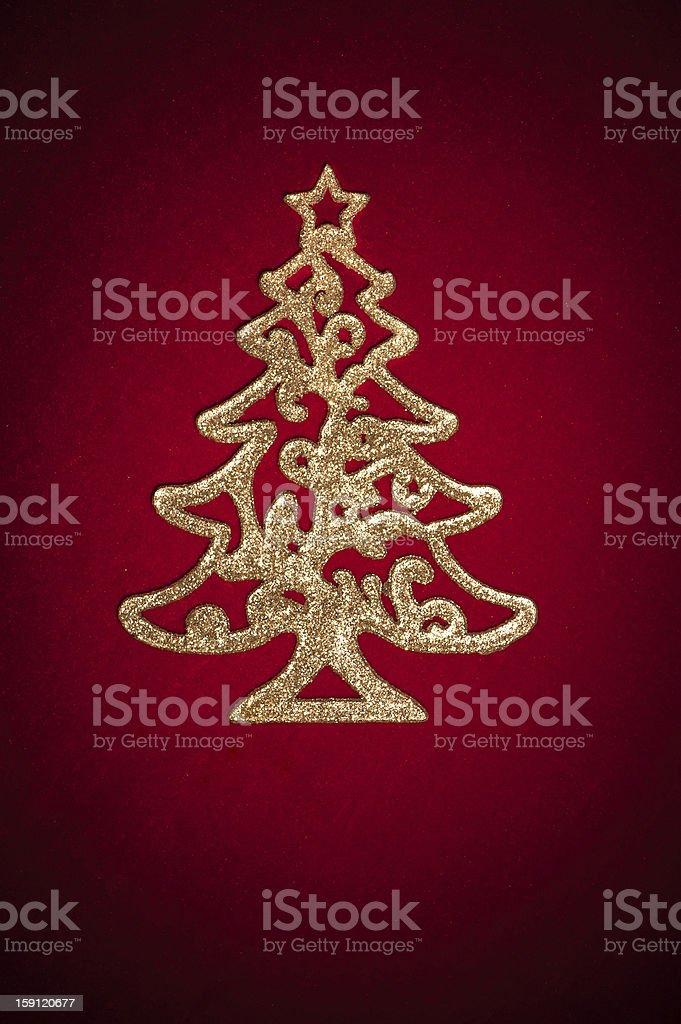 golden fir tree toy on red velvet royalty-free stock photo