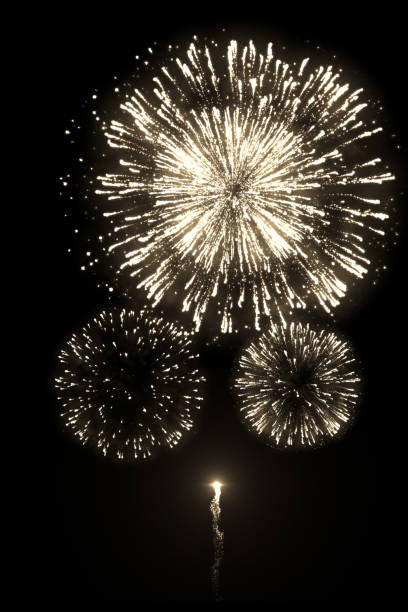 Golden fireworks with trail isolated on the black background A high-quality image of beautiful golden fireworks with trail isolated on the black background for overlay design of celebration new year or festivals pyrotechnic effects stock pictures, royalty-free photos & images