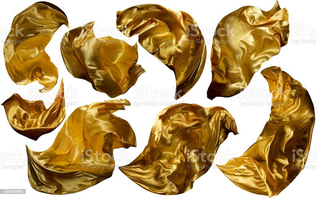 Goldenen fliegen Gewebe, fließt winken Goldstoff, Leuchten gelbe Kleidung drapiert Stück, weiß isoliert - Lizenzfrei Textilien Stock-Foto