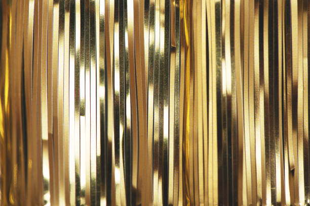 ゴールデンホイルティンセルストリップ。 - glitter curtain ストックフォトと画像