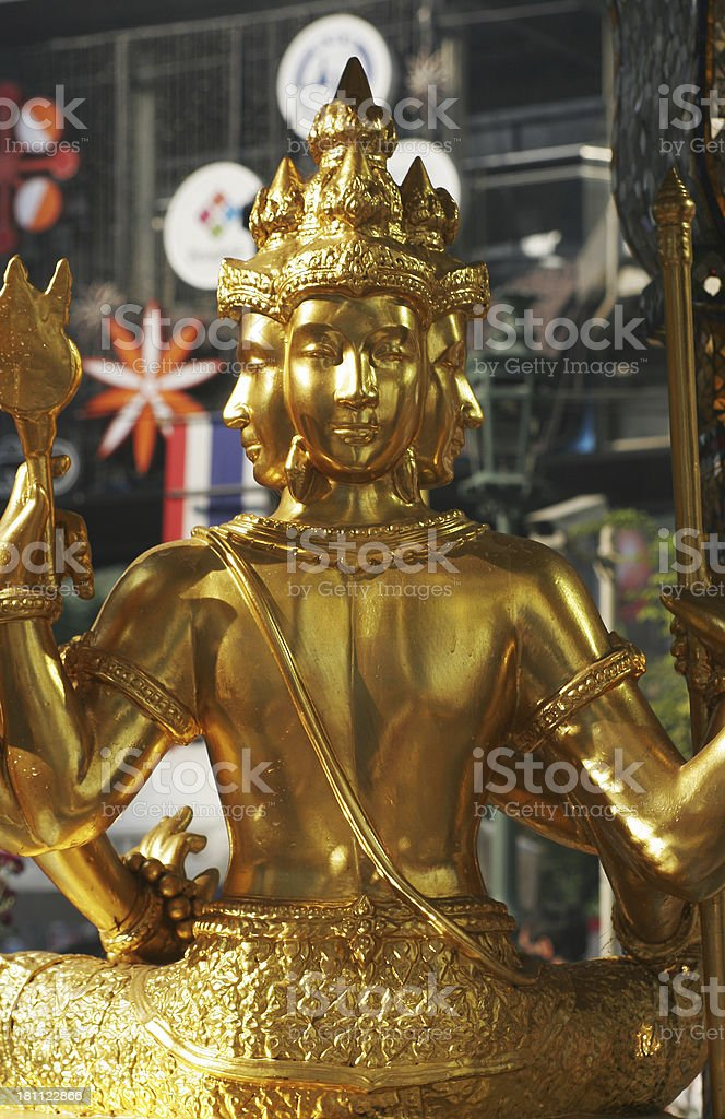 Golden Four Faced Buddha stock photo
