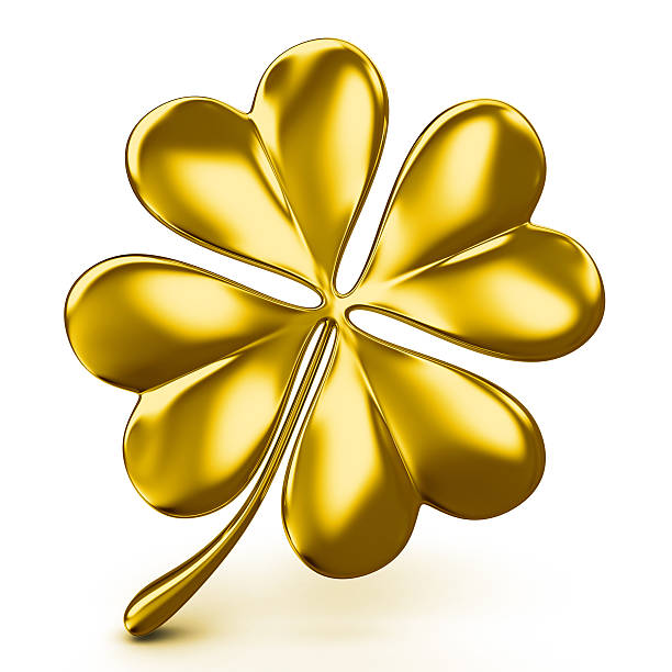 golden four leaf clover - klavertje vier stockfoto's en -beelden