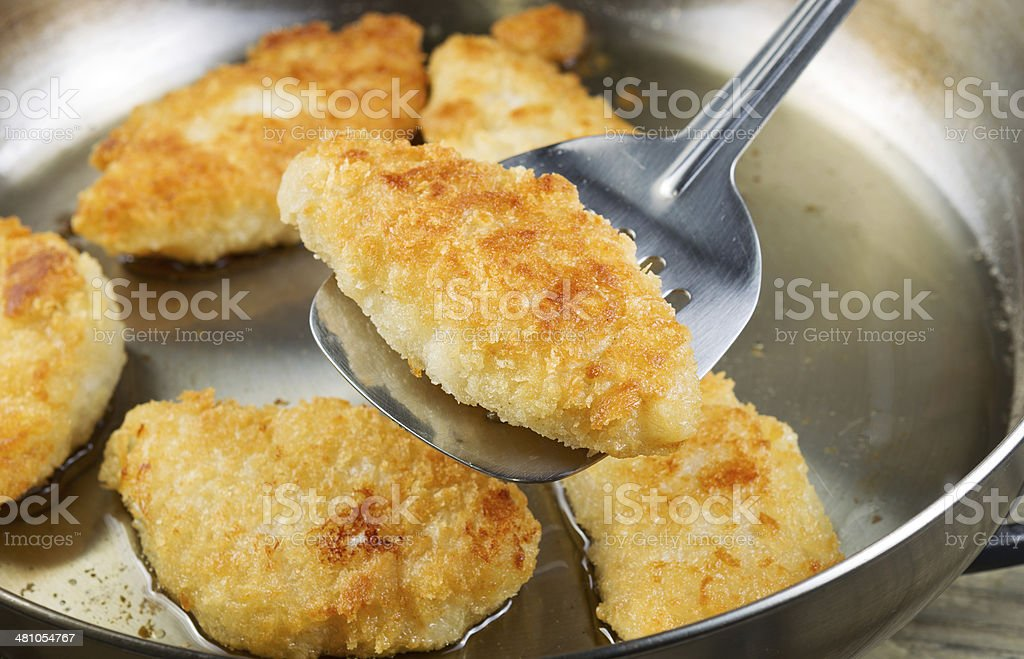Golden Fried Fish in Pan stock photo
