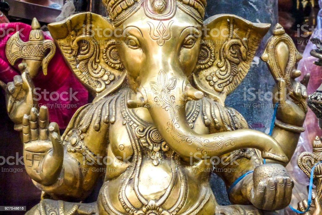 Golden Ganesh statue for sale at a street market Kathmandu, Nepal stock photo