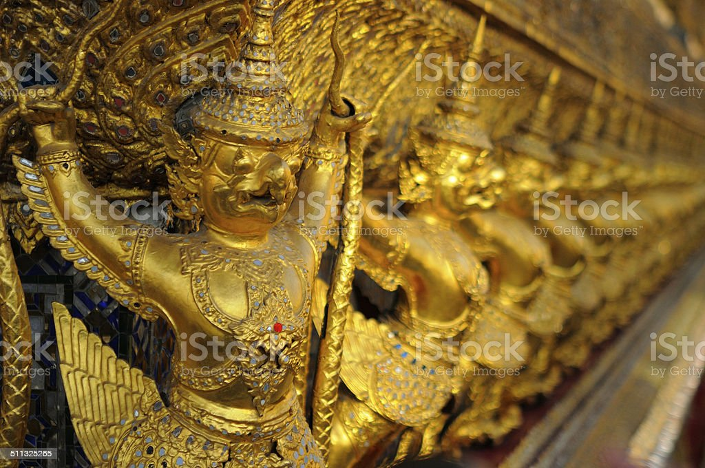 Golden Garudas lining at royal grand palace, bangkok Thailand stock photo