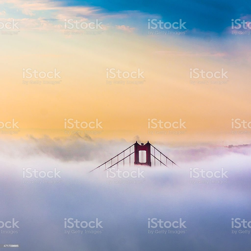 Golden Gate Bridge above Clouds after sunrise in San Francisco royalty-free stock photo