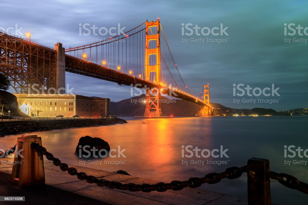 Golden Gate Bridge and Chainlink Fence at Night. stock photo