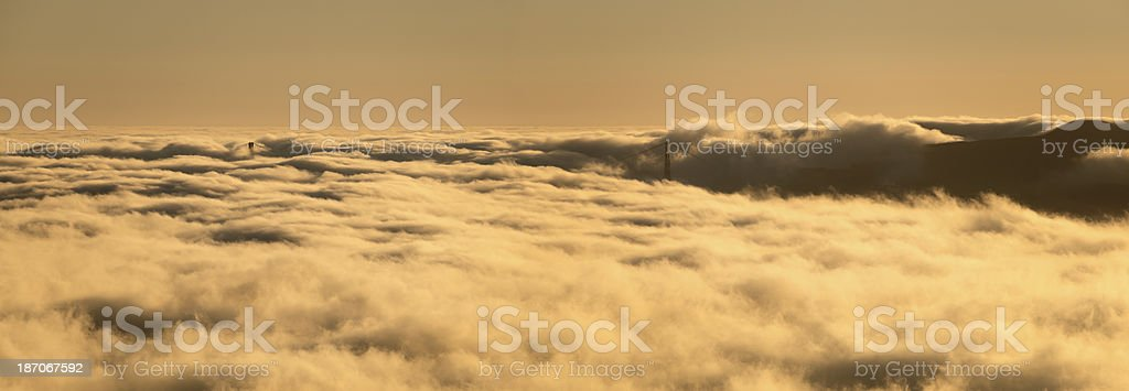 Golden Gate Bridge and coastal hills in dense fog. royalty-free stock photo