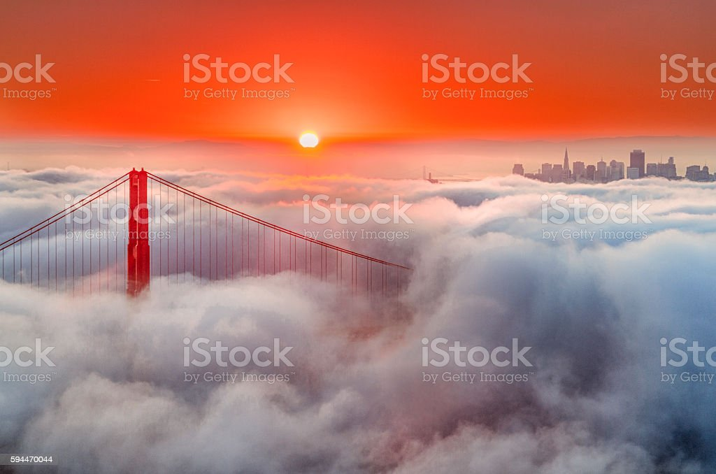 Golden Gate Bridge and Low Fog at sunrise stock photo