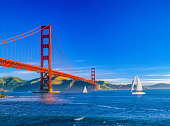 Golden Gate bridge with chain fencing and San Francisco Bay, CA