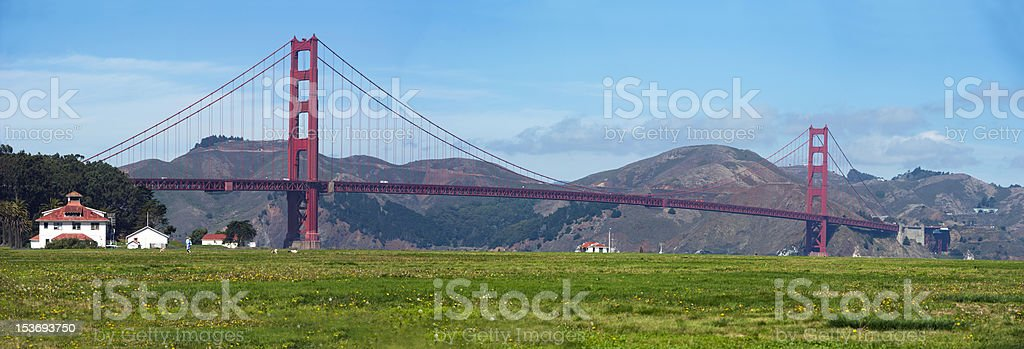 golden gate bridge and summer meadow in san francisco stock photo