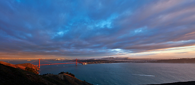 Golden gate bridge and cityscape at dusk dramatic sky, San Francisco, California, USA.