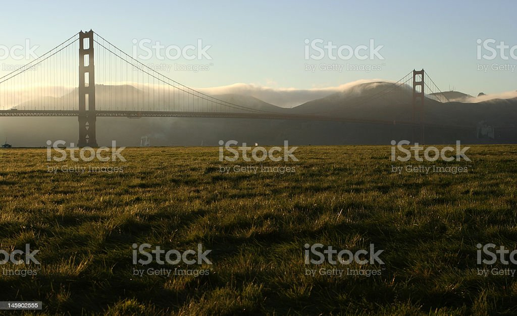 Golden Gate bridge at Dusk with fog coming royalty-free stock photo
