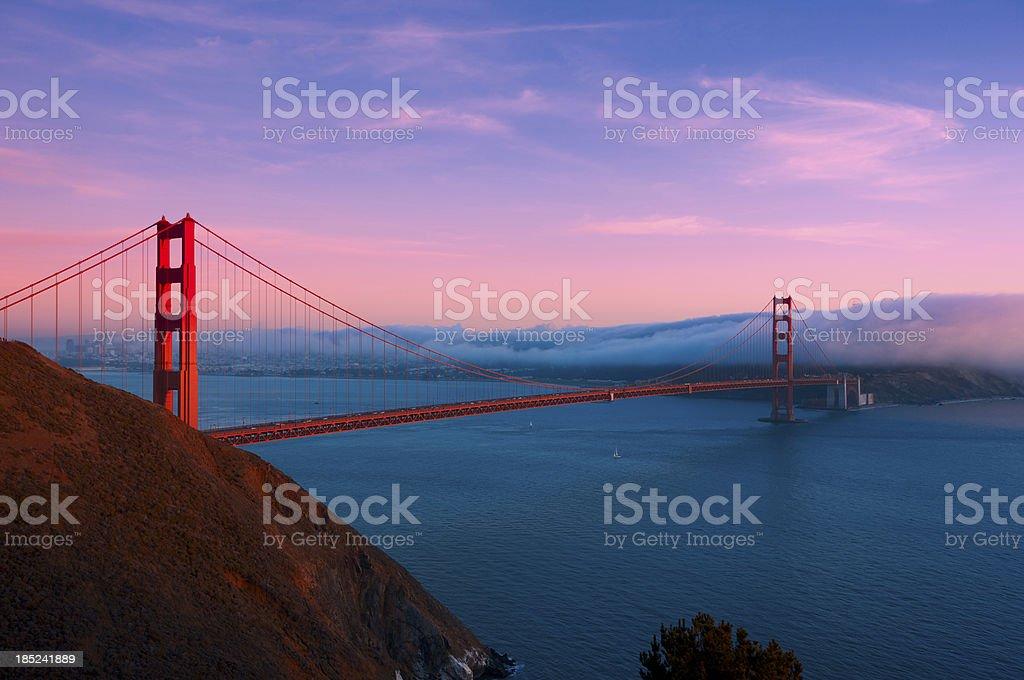 Golden Gate Bridge at sunset with fog stock photo