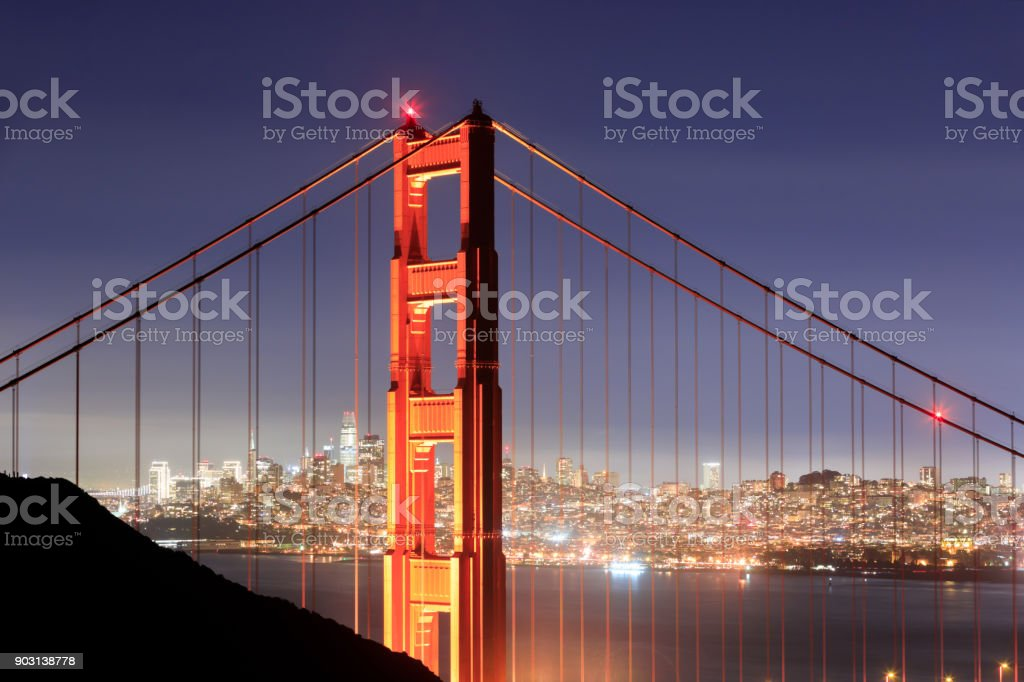 Golden Gate Bridge Close-up with San Francisco Skyline Background on a clear winter night stock photo
