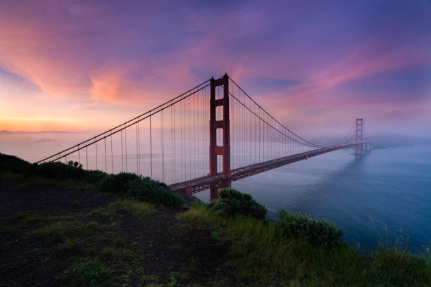 Golden Gate bridge during sunrise from Battery Spencer Golden Gate bridge during sunrise from Battery Spencer golden gate bridge stock pictures, royalty-free photos & images