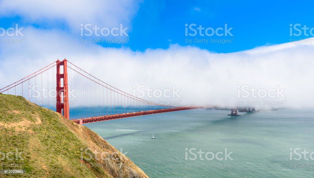 Golden Gate Bridge in clouds on a beautiful summer day  - Panoramic view from Battery Spencer -  California, USA stock photo