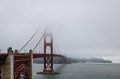 istock Golden Gate Bridge in mist clouds 1324268254