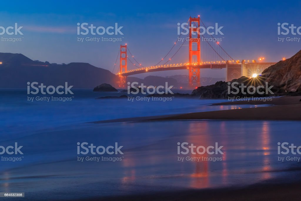 Golden Gate Bridge in San Francisco from Baker Beach at sunset royalty-free stock photo