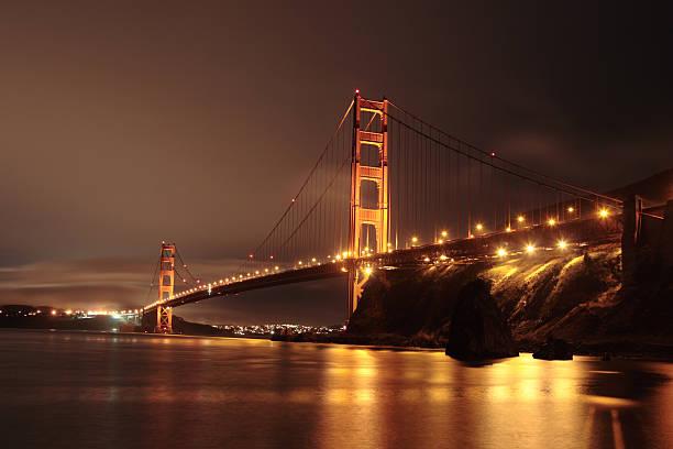 Golden Gate Bridge in the night stock photo