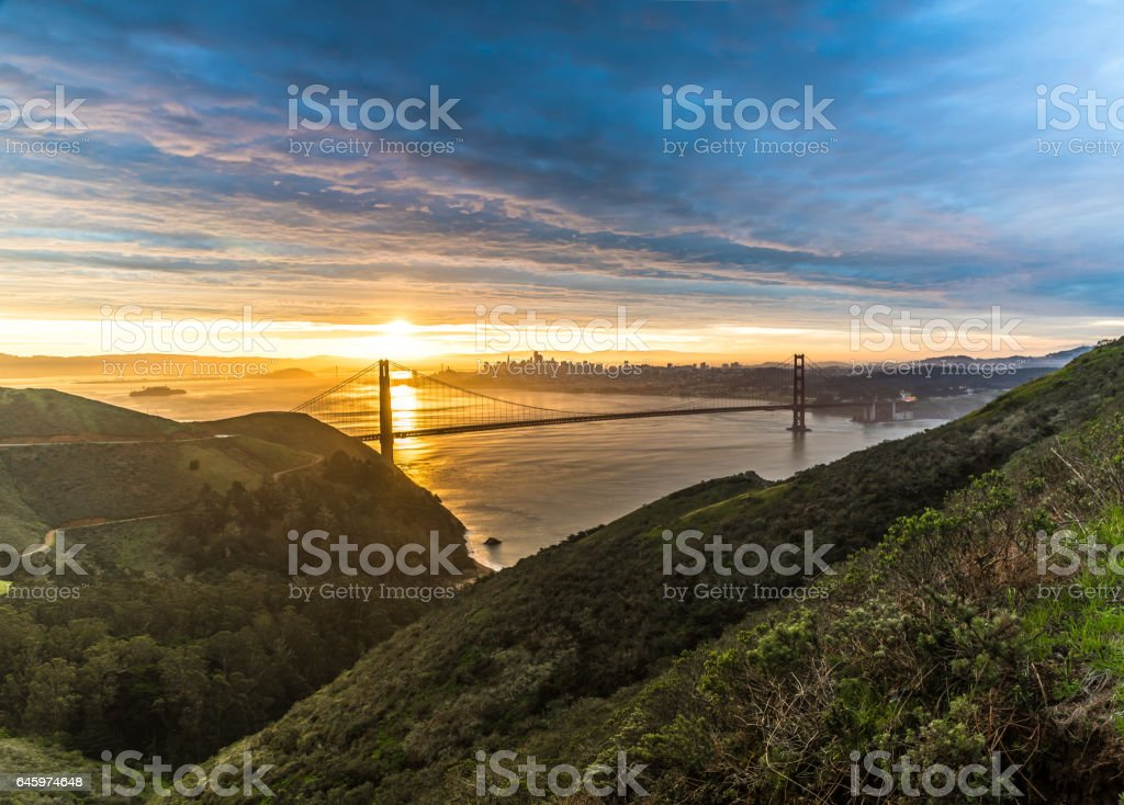 Golden Gate Bridge lit by first sun rays stock photo