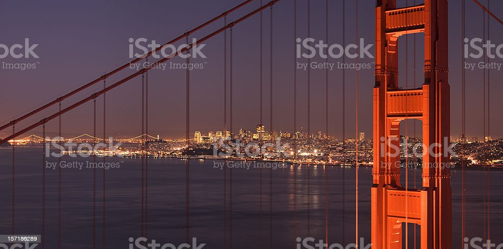 Golden Gate Bridge: Marin Tower close-up, San Francisco in background royalty-free stock photo