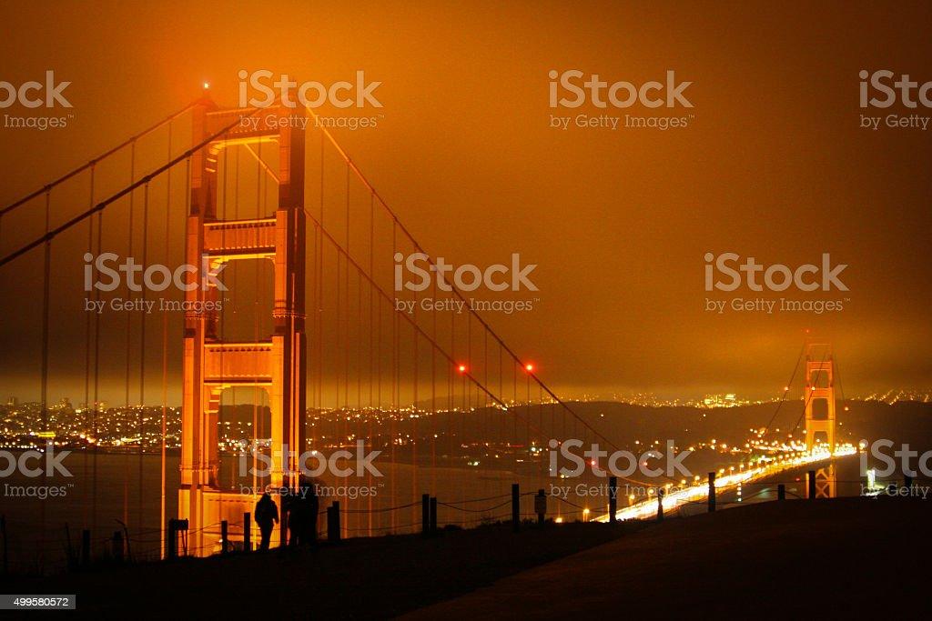 Golden Gate bridge on a cloudy, windy night. stock photo