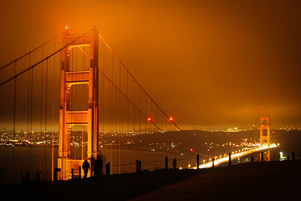 Golden Gate bridge on a cloudy, windy night. stock photo