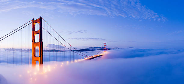 Golden Gate Bridge San Francisco USA The Golden Gate bridge in San Francisco surrounded by fog at twilight, USA. golden gate bridge stock pictures, royalty-free photos & images