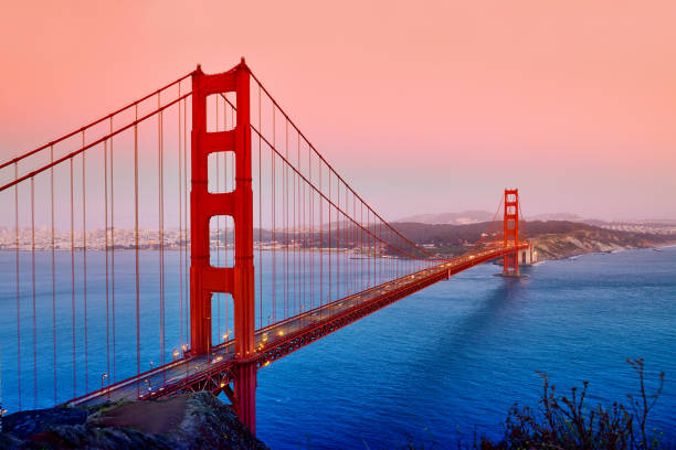 Golden Gate Bridge, San Francisco, USA Golden gate bridge at sunset in dramatic sky, San Francisco, USA. golden gate bridge stock pictures, royalty-free photos & images