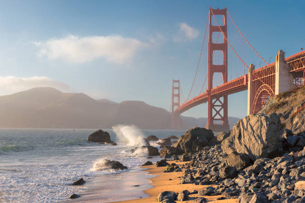 Golden Gate Bridge seen from San Francisco beach, California. Golden Gate Bridge at sunset seen from the Marshall's Beach in San Francisco, California. golden gate bridge stock pictures, royalty-free photos & images