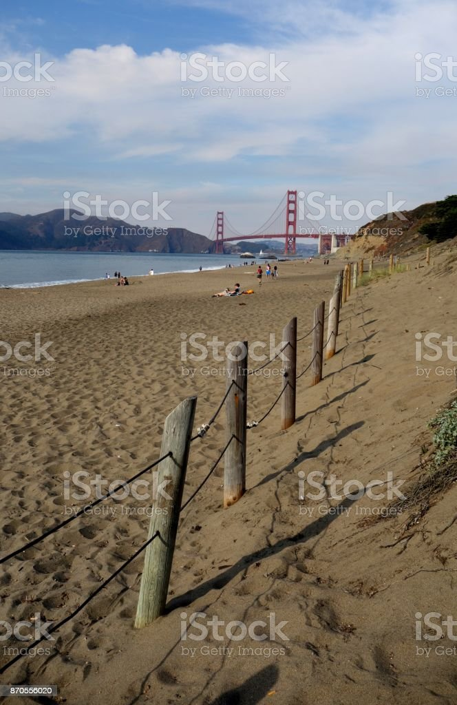 Golden Gate Bridge with Beach and a fence stock photo