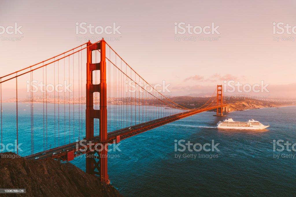 Golden Gate Bridge with cruise ship at sunset, San Francisco, California, USA stock photo