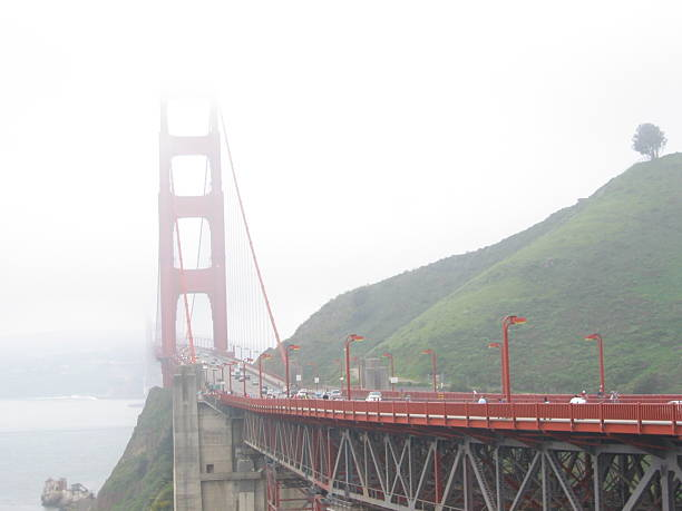 golden gate bridge with fog - ccsccs7 stock pictures, royalty-free photos & images