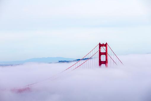 famous Golden Gate Bridge with low fog, San Francisco, USA