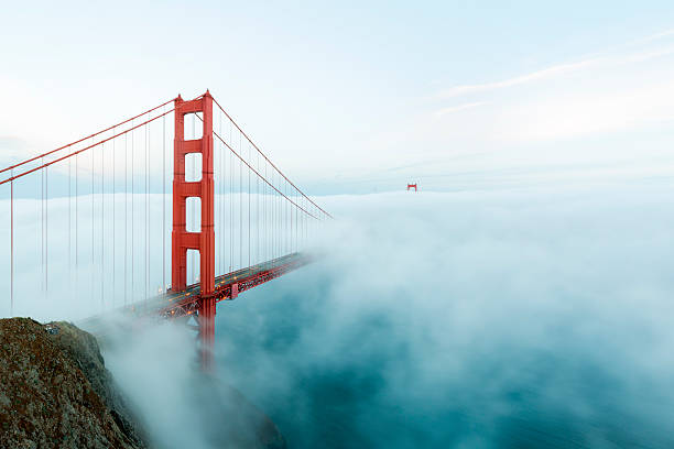 Golden Gate Bridge with low fog, San Francisco famous Golden Gate Bridge with low fog, San Francisco, USA golden gate bridge stock pictures, royalty-free photos & images
