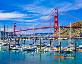 Calm harbor with sail boats and the Golden Gate Bridge, San Fransico, CA
