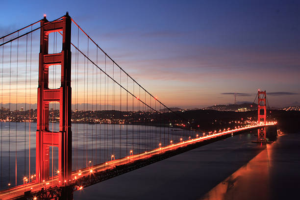 golden gate bridge with sunrise stock photo