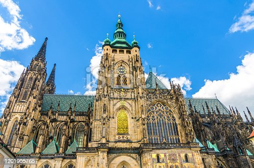 istock Golden Gate South Tower with clock - exterior of St. Vitus Cathedral or The Metropolitan Roman Catholic Cathedral in Prague Castle Hradcany Lesser Town district, Bohemia, Czech Republic 1201905765
