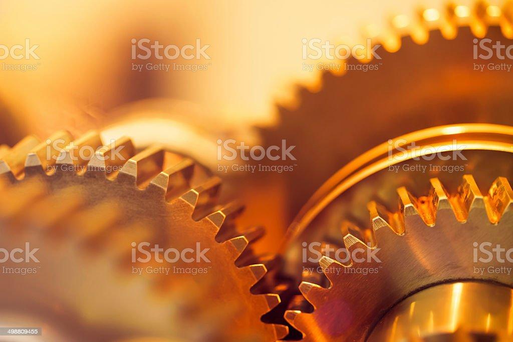 golden gear wheels stock photo