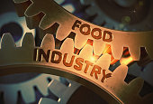 Food Industry - Concept. Food Industry on Mechanism of Golden Cog Gears with Glow Effect. 3D Rendering.