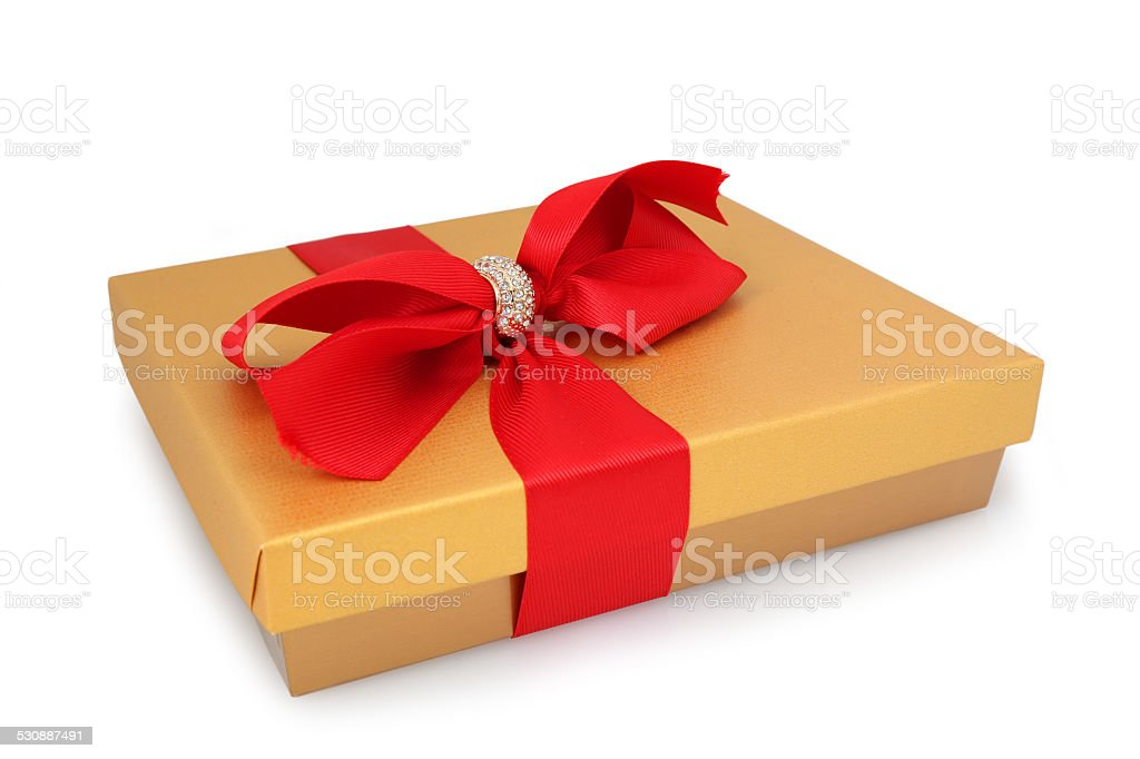 Golden Gift Box with Red Ribbon stock photo