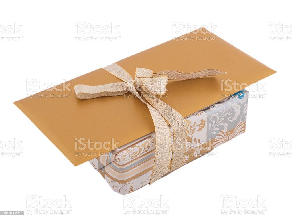 golden gift on white background with golden envelope stock photo