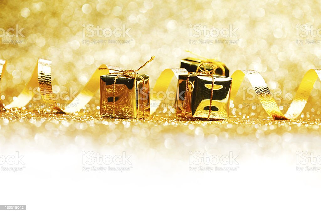Golden gifts and ribbon royalty-free stock photo