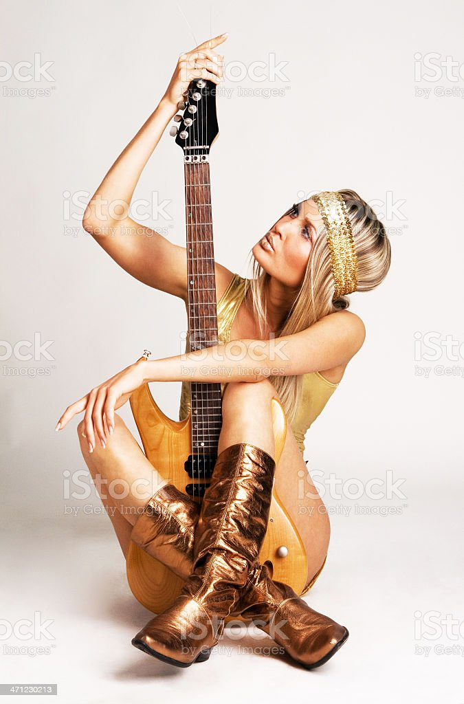 Golden girl with electric guitar royalty-free stock photo
